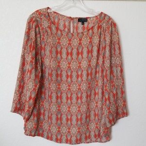 The Limited orange print blouse.